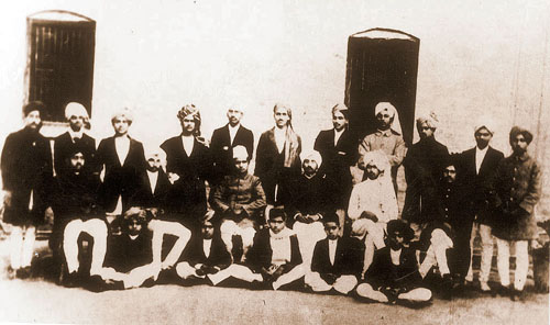 Photograph of the staff and students of the National College, Lahore, founded in 1921 by Lala Lajpat Rai with a view to training students for the non-cooperation movement. Standing, fourth from the right, is Bhagat Singh, later to be executed by the British for his revolutionary activities.