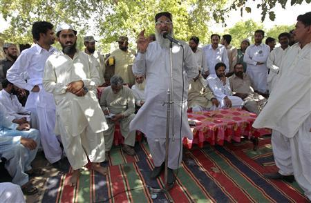 Radical Deobandi cleric Maulana Ahmed Ludhianvi addresses his supporters during his election campaign in Jhang, Punjab province