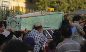 Egyptians carry the coffin of a Shia victim who was killed in sectarian violence in Cairo. Photo taken June 24, 2013.