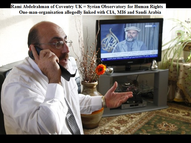 The director of the Syrian Observatory for Human Rights, Rami Abdulrahman, speaks on the phone in his home in Coventry