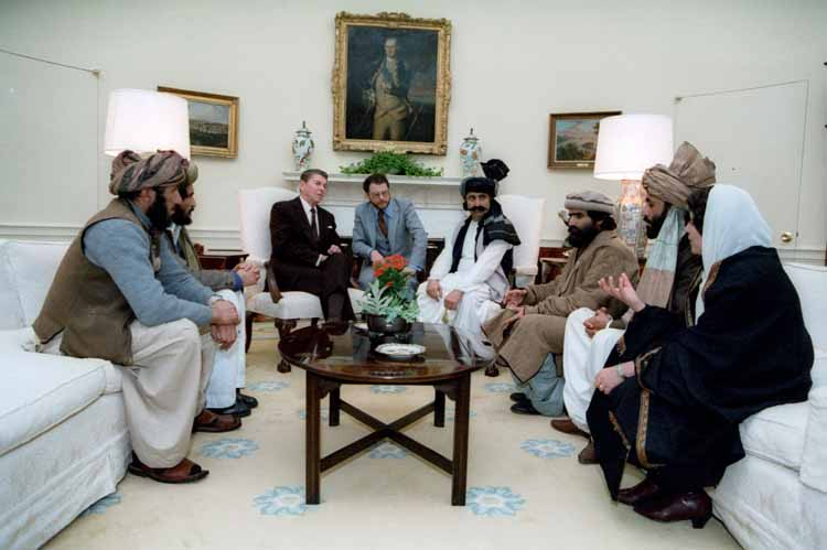 Reagan_sitting_with_people_from_the_Afghanistan-Pakistan_region_in_February_1983
