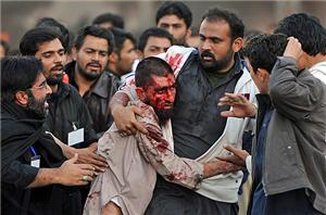 Shia mourners helping a Sunni after the Rawalpindi attack.