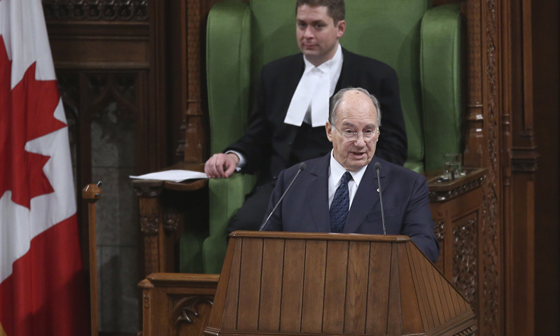 Aga Khan, spiritual leader of Ismaili Muslims, addresses a joint session of Parliament as House of Commons Speaker Andrew Scheer listens in Ottawa
