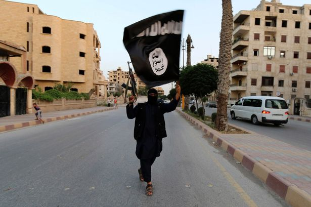 A-member-loyal-to-the-Islamic-State-in-Iraq