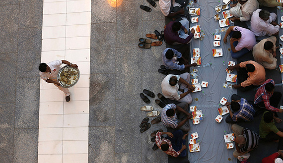 Muslims wait to have their Iftar meal on the first day of Ramadan in Riyadh