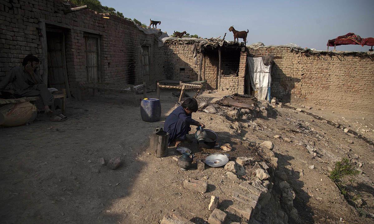 Samiullah washes dishes at a coal mine in Choa Saidan Shah, Punjab province
