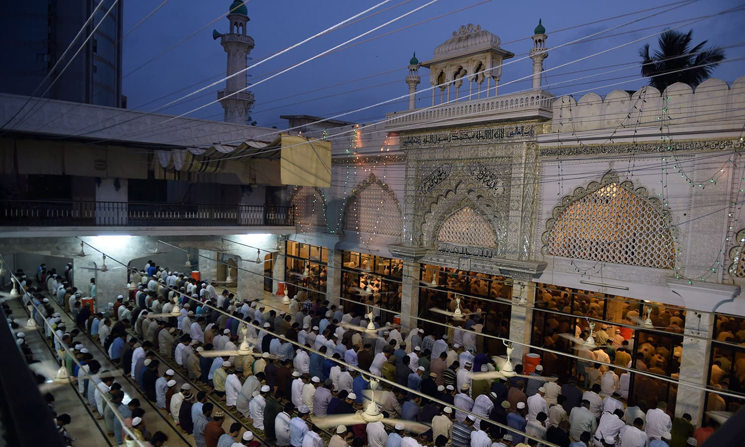 Pakistani Muslims offer special prayers at a mosque to mark Shab-e-Barat or the night of forgiveness in Karachi on June 2, 2015. Muslims believe that if someone prays to God throughout the night and seeks forgiveness for all the sins he may have committed, he could be forgiven. The entire night of prayer is devoted to asking for forgiveness for the past year and for good fortune in the year to come. AFP PHOTO/Asif HASSAN