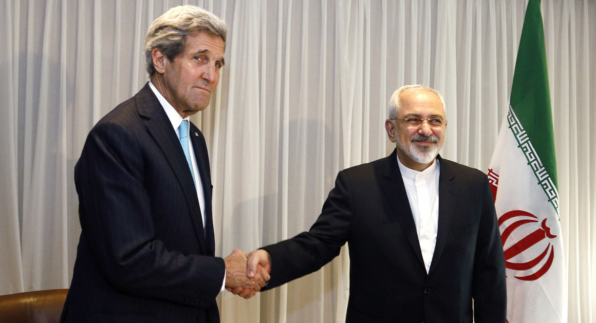 Iranian Foreign Minister Mohammad Javad Zarif shakes hands on January 14, 2015 with US State Secretary John Kerry in Geneva. Zarif said on January 14 that his meeting with his US counterpart was vital for progress on talks on Tehran's contested nuclear drive. Under an interim deal agreed in November 2013, Iran's stock of fissile material has been diluted from 20 percent enriched uranium to five percent, in exchange for limited sanctions relief.   AFP PHOTO / POOL / RICK WILKING        (Photo credit should read RICK WILKING/AFP/Getty Images)