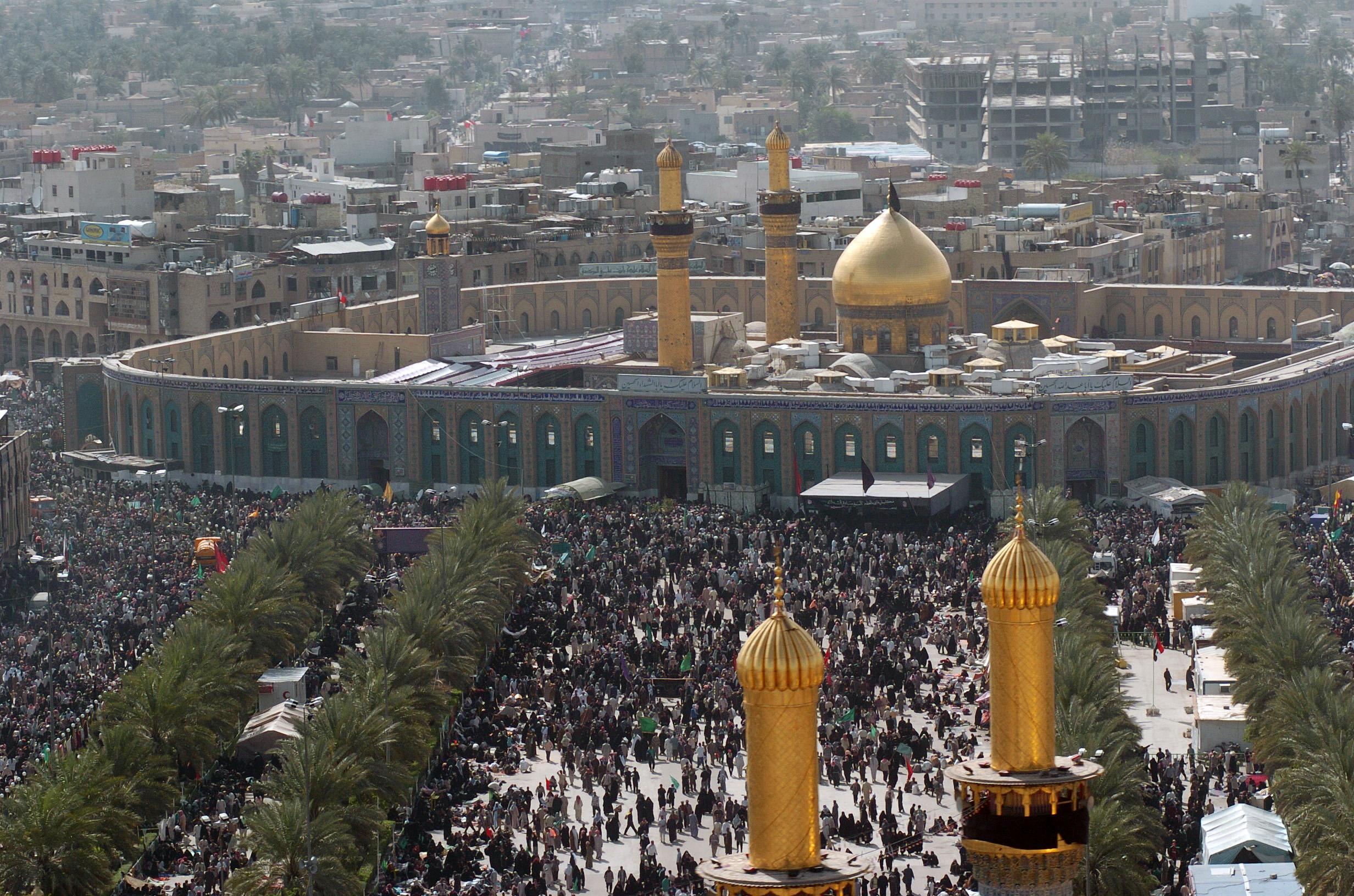 Hundreds of ShiÕa Muslims gather around the Husayn Mosque in Karbala after making the Pilgrimage on foot during Arba'een. Arba'een is a forty day period that commemorates the martyrdom of Husayn bin Ali, grandson of the Prophet Muhammad, and seventy-two of his followers at the Battle of Karbala in the year 680AD.