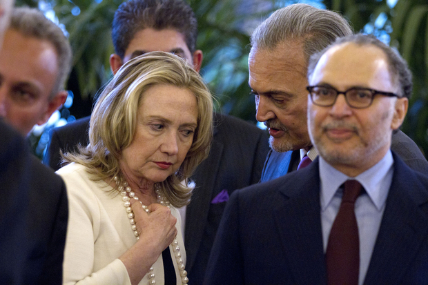 US Secretary of State Hillary Rodham Clinton (L) speaks with Saudi Arabia's Foreign Minister Saoud Al-Faysal Bin Abdelaziz Al Saoud during a meeting on Syria at the French foreign ministry in Paris, on April 19, 2012. Syria and the United Nations signed a deal Thursday on the framework for observers monitoring a shaky ceasefire, as Arab and Western ministers gathered in Paris. AFP PHOTO/POOL/Jacquelyn Martin / AFP PHOTO / POOL / JACQUELYN MARTIN
