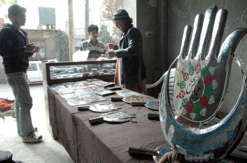 QUETTA, PAKISTAN, NOV 28: A shopkeeper sells Azadari Items for Muharram-ul-Haram at his shop at Alamdar road in Quetta on Monday, November 28, 2011. (Arsalan Naseer/PPI Images).