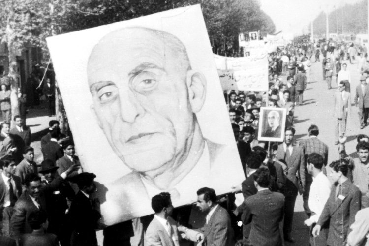 Shiraz, Iran: Vast portraits of Premier Mossadeq are carried by demonstrators in Shiraz, about 450 miles south of Teheran, in support of the Premier's demand for the passage by the Majlis of the eight-man report limiting the powers of the Shah. 20 April 1953 Great Britain / Mono Negative