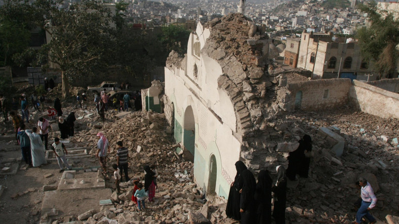 People gather among the rubble of a Sufi mosque that was blown up by explosive devices in an attack in the southwestern city of Taiz, Yemen, July 30, 2016. There were no casualties and no groups have claimed responsibility for the attack, according to local media. REUTERS/Anees Mahyoub